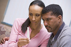Couple looking at a home pregnancy test